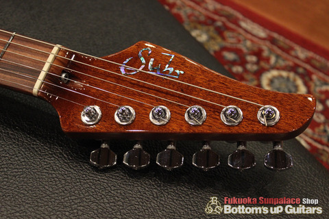 Suhr_Modern_Fixed_BlackKorina_Ashback_Headtop.jpg